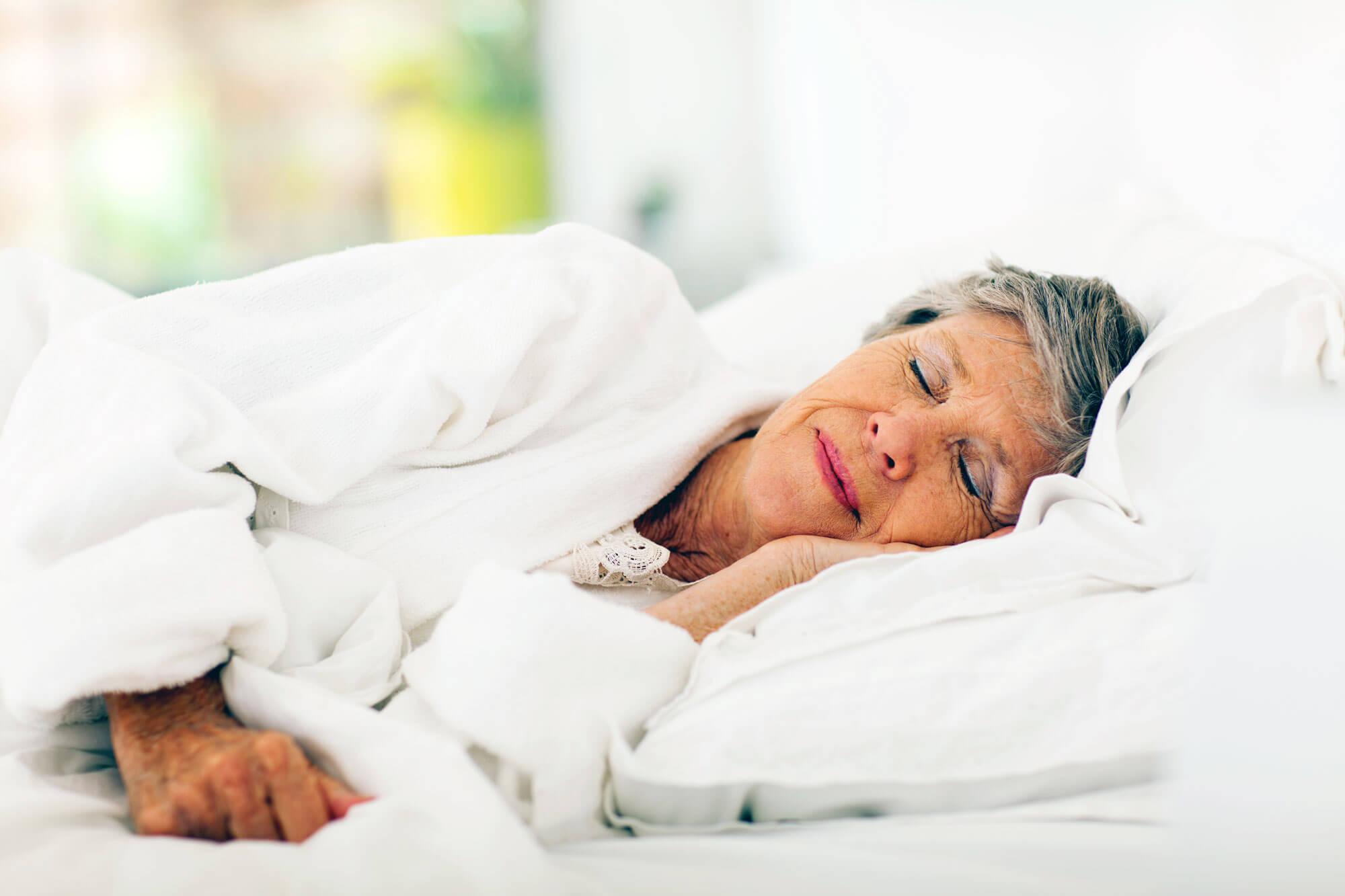 senior woman sleeping bed